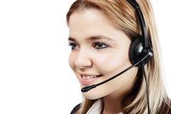 Uśmiechnięta blondynki kobieta z hełmofonami przy centrum telefonicznym obraz royalty free