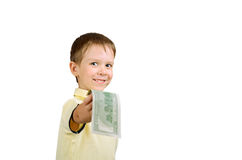 Uśmiechnięta chłopiec daje pieniądze rachunkowi 100 my dolary odizolowywający dalej Zdjęcia Stock