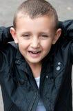 Uśmiechnięta chłopiec uśmiechnięty Zdjęcia Royalty Free