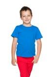 Uśmiechnięta chłopiec w błękitnej koszula fotografia royalty free