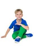 Uśmiechnięta chłopiec w błękitnej koszula obraz stock