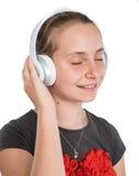 Uśmiechnięta dziewczyna w hełmofonach Zdjęcia Stock