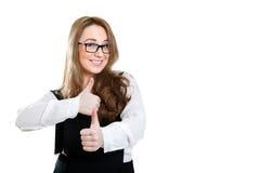 Uśmiechnięta dziewczyna w szkieł przedstawieniach gestykuluje znakomitego Fotografia Stock