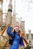 Uśmiechnięta dziewczyna z zakupami w Barcelona Obraz Stock