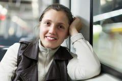Uśmiechnięta kobieta w metrze Obraz Stock