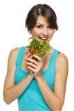 Uśmiechnięta kobiety łasowania sałatka Zdjęcia Royalty Free