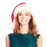 Uśmiechnięta kobiety kobieta w Santa kapeluszu Bożenarodzeniowy moda model Fotografia Stock