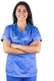 Uśmiechnięta lekarka z ona ręki składać Zdjęcia Stock