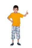 Uśmiechnięta młoda chłopiec z jego kciukiem up fotografia royalty free