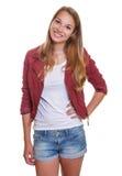 Uśmiechnięta młoda dziewczyna w krótkich spodniach obraz royalty free