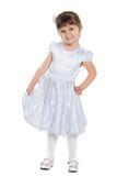 Uśmiechnięta mała dziewczyna przeciw bielowi Obrazy Stock