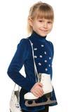 Uśmiechnięta mała dziewczynka z łyżwami fotografia royalty free
