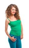 Uśmiechnięta piękna młoda kobieta w zielony odgórny odosobnionym Fotografia Royalty Free