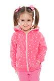 Uśmiechnięta preschool dziewczyna przeciw bielowi obraz stock