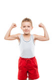 Uśmiechnięta sporta dziecka chłopiec seansu ręki bicepsów mięśni siła Fotografia Royalty Free