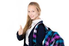 Uśmiechnięta szkolna dziewczyna pokazuje aprobaty Obrazy Stock