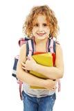 Uśmiechnięta szkolna dziewczyna z plecaka mienia książkami Obraz Stock