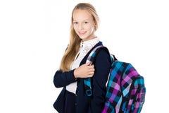 Uśmiechnięta szkolna dziewczyna z w kratkę plecakiem Zdjęcie Stock