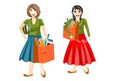 Uśmiechnięte kobiety z bagażnikami Zdjęcia Stock