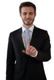 Uśmiechniętego biznesmena wzruszający palec wskazujący na interfejsie Obraz Royalty Free