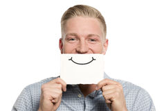 Życzliwy biznesmen przedstawia pustą biel kartę. Obraz Stock