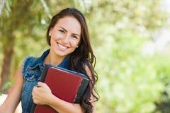 Uśmiechnięty Atrakcyjny Mieszany Biegowy Nastoletni dziewczyna uczeń z Szkolnymi książkami obraz royalty free