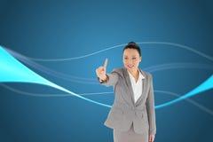 Uśmiechnięty azjatykci bizneswomanu wskazywać Zdjęcie Royalty Free