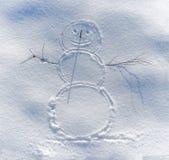 Uśmiechnięty bałwan malujący na śniegu obraz stock