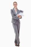 Uśmiechnięty biurowy pracownik z stosem papierkowa robota Fotografia Stock