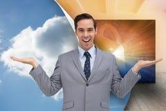Uśmiechnięty biznesmen przedstawia coś z jego ręki Obrazy Stock