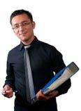 Uśmiechnięty biznesmen trzyma falcówkę na bielu zdjęcia stock