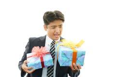 Uśmiechnięty biznesmen z prezentami Obraz Stock