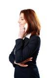 Uśmiechnięty bizneswoman opowiada na telefonie fotografia stock