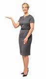 Uśmiechnięty bizneswoman Wystawia Niewidzialnego produkt Zdjęcie Royalty Free