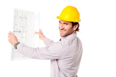 Uśmiechnięty budowa inżynier przegląda projekt Fotografia Stock