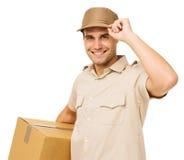 Uśmiechnięty Deliveryman przewożenia karton zdjęcie stock