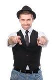 Uśmiechnięty elegancki caucasian mężczyzna wskazuje jego dotyka przy kamerą Obraz Stock