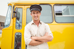 Uśmiechnięty kierowca autobusu patrzeje kamerę Zdjęcie Royalty Free