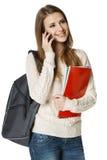 Uśmiechnięty kobieta uczeń opowiada na telefon komórkowy Fotografia Stock