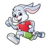 Uśmiechnięty królik jogging obrazy royalty free