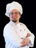 Uśmiechnięty kucbarski szef kuchni na czerni Obraz Royalty Free