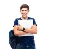 Uśmiechnięty męski uczeń z plecaka mienia falcówkami Obraz Stock