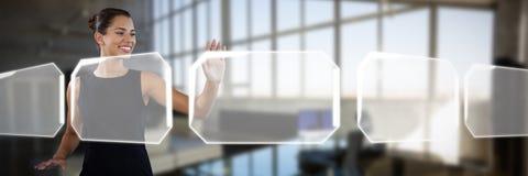 Uśmiechnięty młody bizneswoman używa niewidzialnego interfejs przeciw wnętrzu pusty kreatywnie biuro Zdjęcia Royalty Free