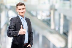 Uśmiechnięty młody męski dyrektor wykonawczy Fotografia Stock