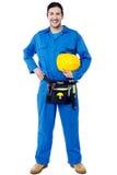 Uśmiechnięty młody pracownik budowlany Obrazy Royalty Free
