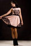 Uśmiechnięty nastolatek pokazuje daleko jej suknię Zdjęcie Royalty Free