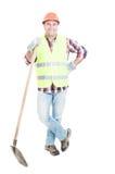 Uśmiechnięty pracownik budowlany z hełmem i łopatą Zdjęcie Stock