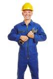 Uśmiechnięty pracownik z hełma i szczęki wyrwaniem obrazy stock