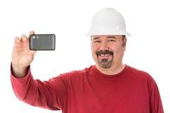 Uśmiechnięty robociarz bierze autoportret obrazy stock