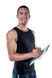 Uśmiechnięty sporta trenera writing na schowku Zdjęcie Royalty Free